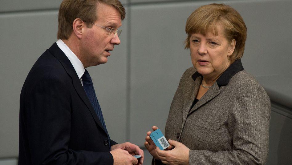 Hat in fünf Monaten mehr verdient als Merkel in einem Jahr: Ex-Kanzleramtsminister Ronald Pofalla (links)