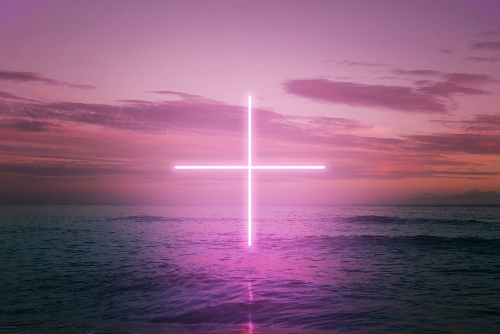 Creative picture performance of digital neon cross in the middle of the sea with sunset sky.