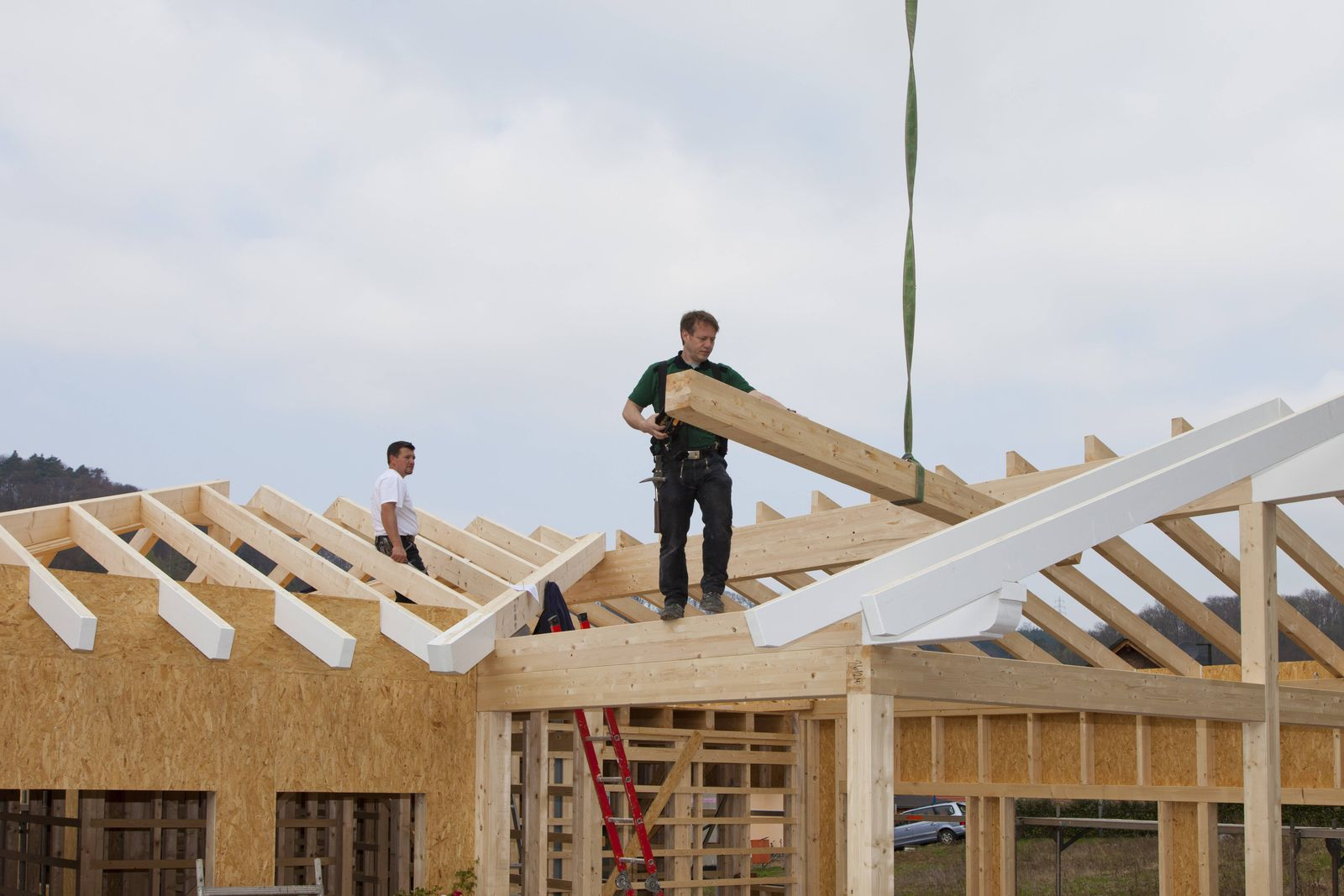 Europe Germany Rhineland Palatinate Men working on roof of house model released property released