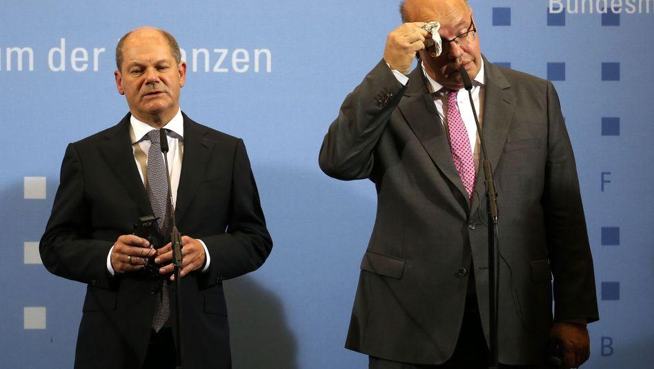 Bundesfinanzminister Olaf Scholz (l.) und Bundeswirtschaftsminister Peter Altmaier (Bild Archiv) haben mit Lufthansa-Großaktionär Heinz Hermann Thiele und Konzernchef Carsten Spohr über den staatlichen Rettungsplan für die Airline gesprochen.