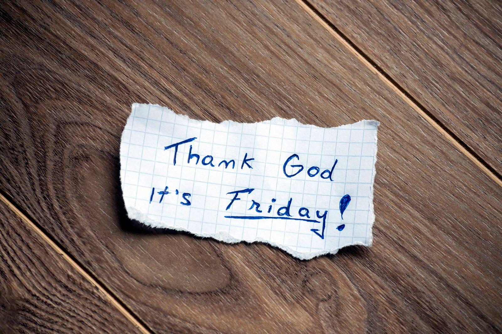 Thank God it s Friday! Friday message written on piece of paper, on a wood background. PUBLICATIONxINxGERxSUIxAUTxONLY C