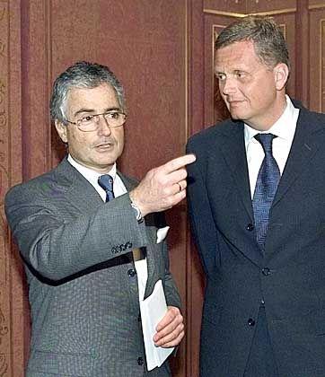 """""""Da gehts lang"""" - Kai-Uwe-Ricke (r.) gilt als Ziehkind von Ex-Vorstandschef Sommer. Wird er jetzt einfach den ridgiden Sparkurs von Interimschef Sihler umsetzen?"""