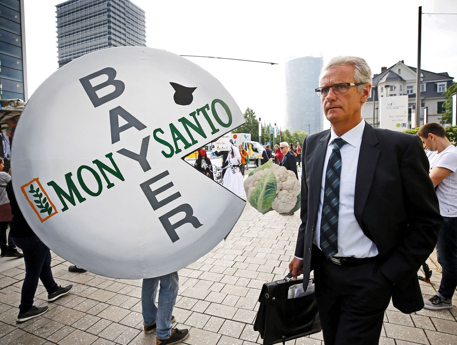 A Bayer's shareholder arrives at the annual general shareholders meeting in Bonn