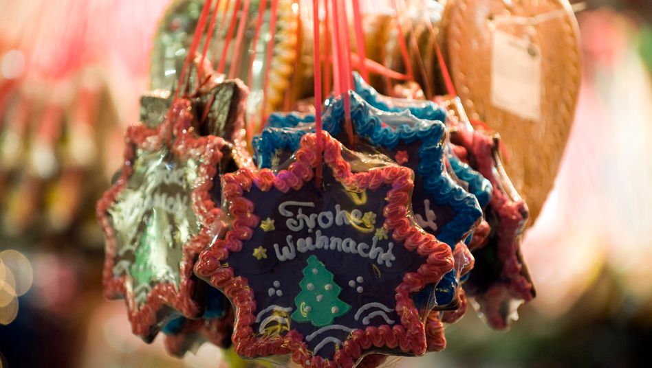Lebkuchen auf Weihnachtsmarkt: Der Handelsstreit mit den USA trifft die Branche.