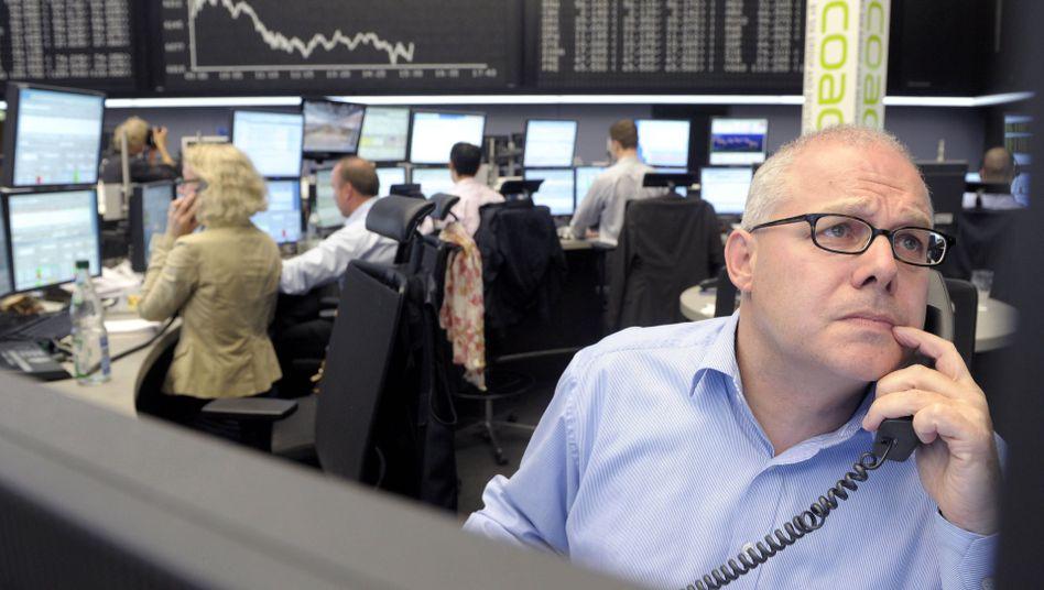 Händler in Frankfurt: Die Börsenwoche beginnt mit Verlusten