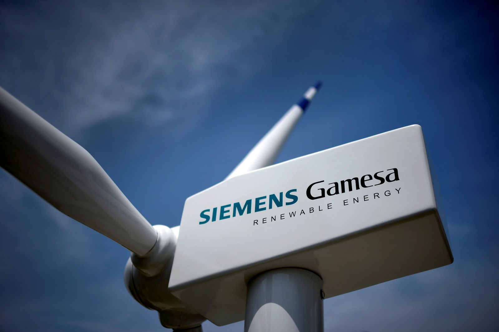 FILE PHOTO: A model of a wind turbine with the Siemens Gamesa logo is displayed outside the annual general shareholders meeting in Zamudio