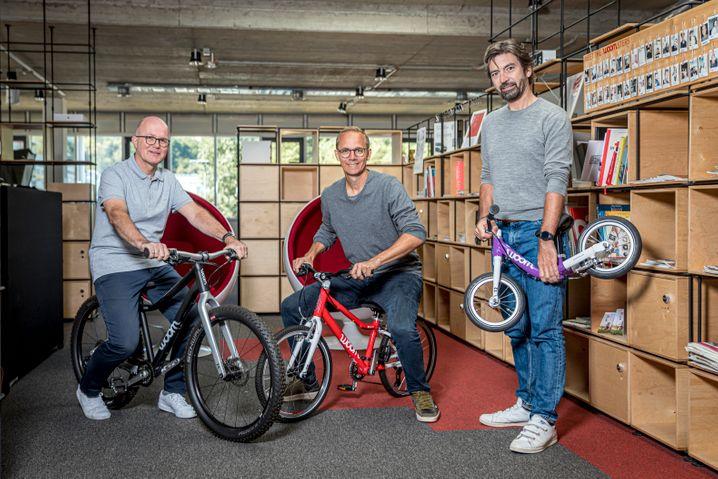 Woom-Boom: Die Gründer Markus Ihlenfeld (M.) und Christian Bezdeka (r.) und Geschäftsführer Guido Dohm
