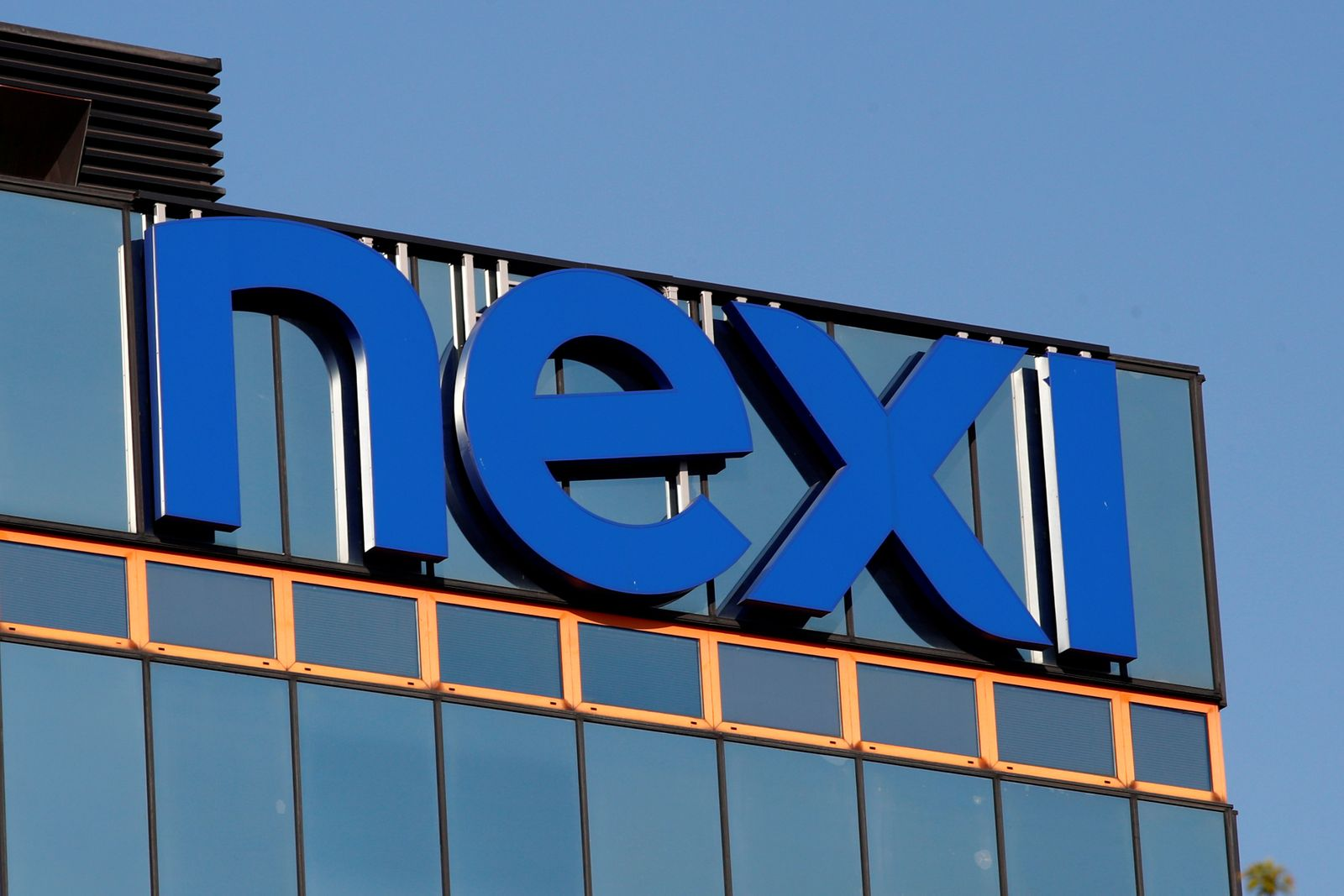 FILE PHOTO: The logo of Italian payments group Nexi is pictured outside their headquarters in Milan
