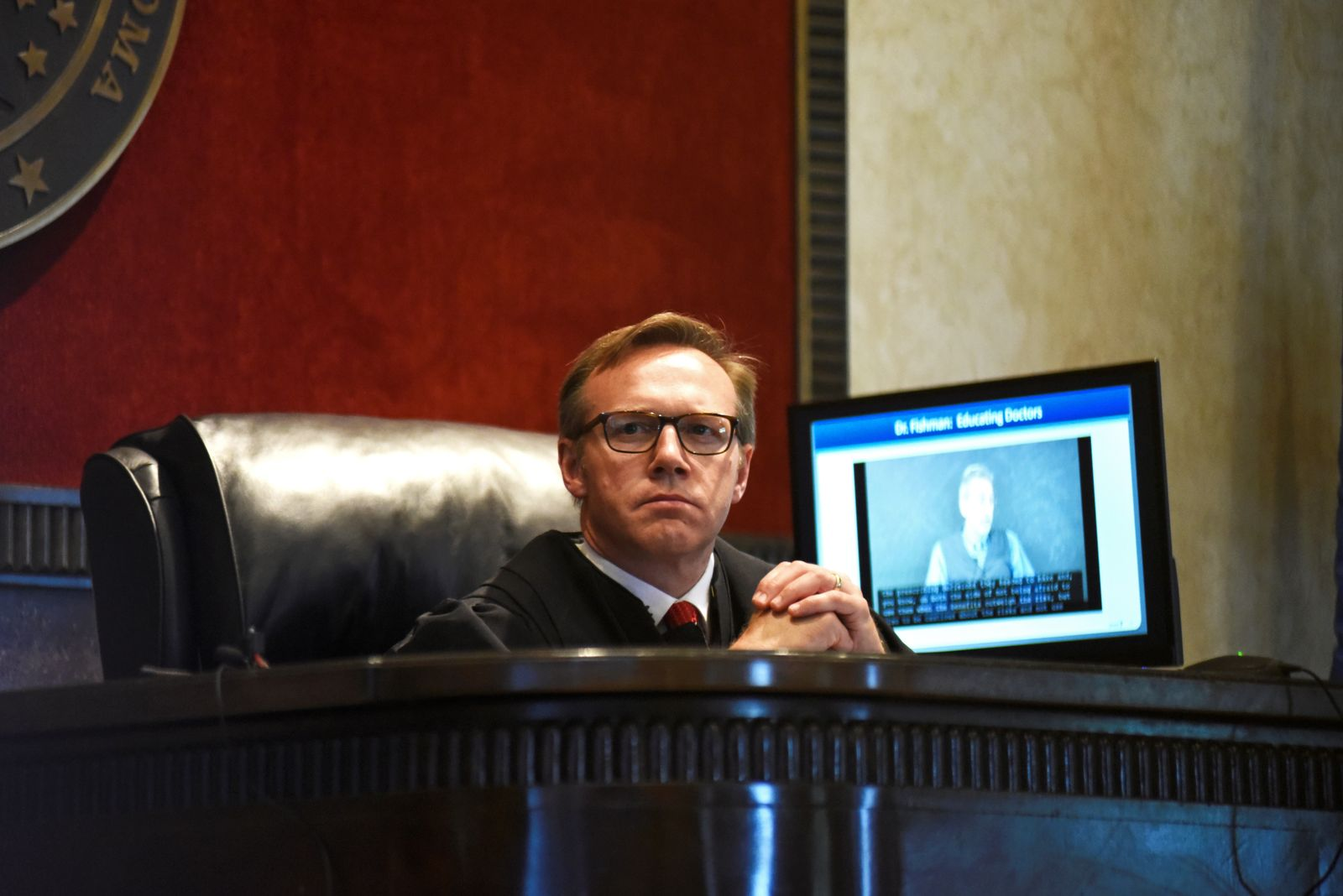 Judge Thad Balkman listens to a piece of evidence on the first day of a trial of Johnson & Johnson in Norman