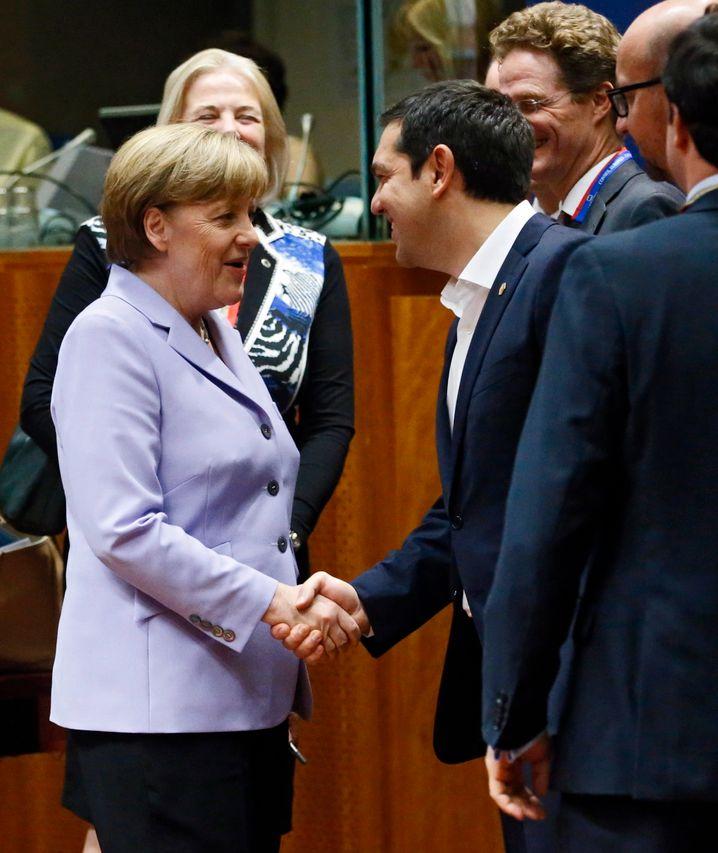 Erst gestern trafen sie sich in Brüssel: Heute sprachen Kanzlerin Merkel und Griechenlands Premier Tsipras erneut miteinander
