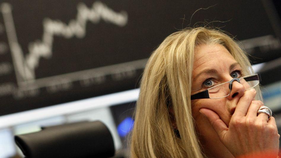 Händlerin an der Börse: Der Dax steigt, der Dow Jones erreicht Rekordniveau
