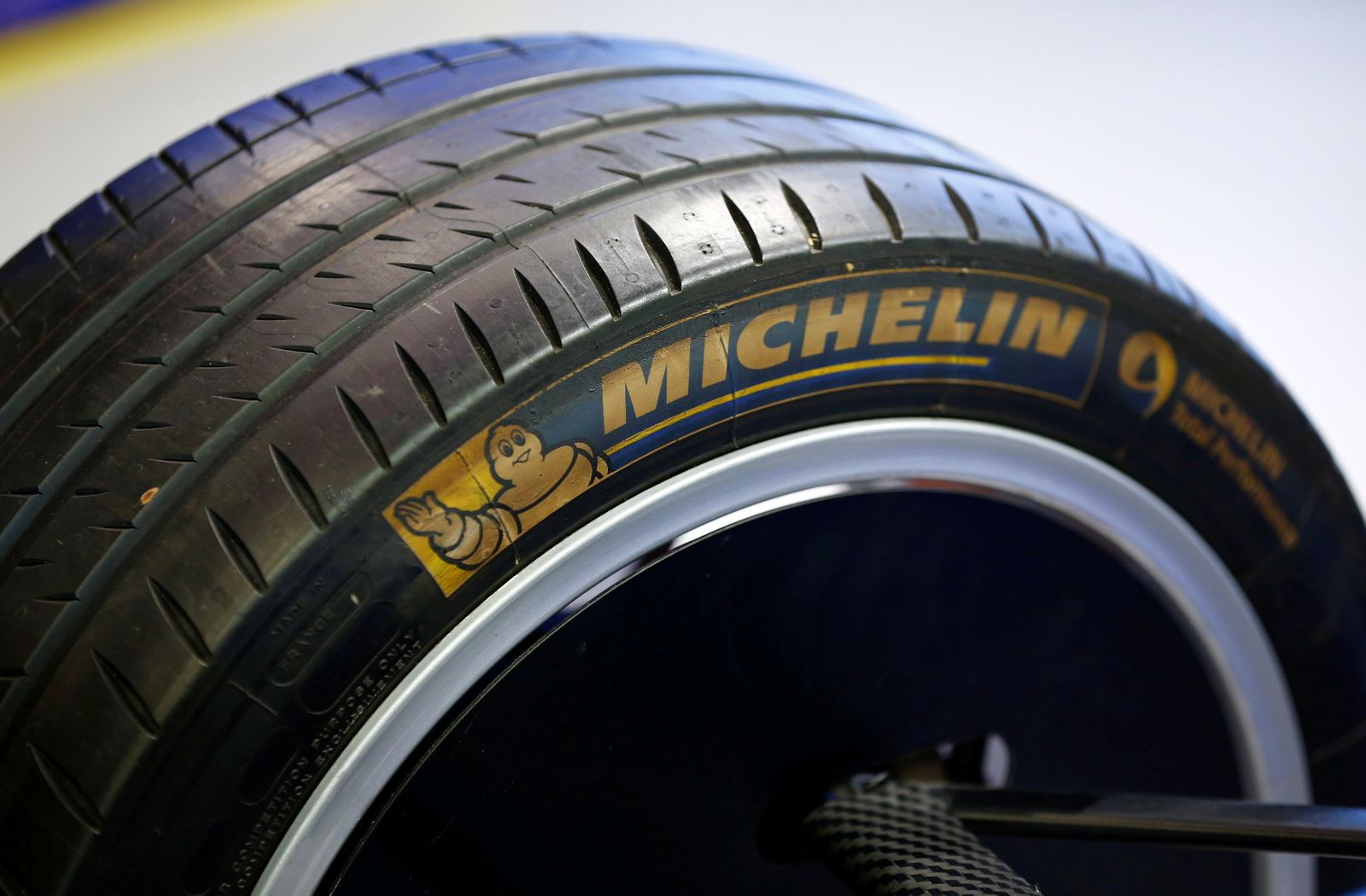 FILE PHOTO: The logo of French tyre maker Michelin on a tyre of a Formula E racing car