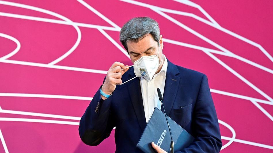 Legt die Maske ab: Markus Söder hofft auf eine Entscheidung in dieser Woche, ob er oder Armin Laschet die CDU in die Bundestagswahl führen