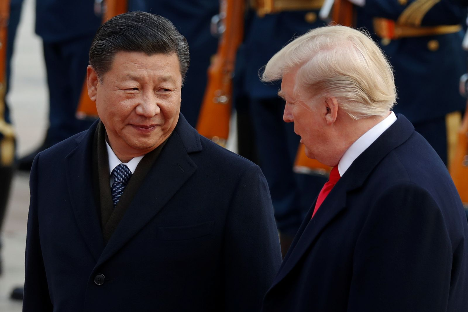 U.S. President Donald Trump takes part in a welcoming ceremony with China's President Xi Jinping at the Great Hall of the People in Beijing