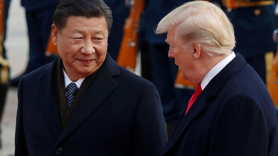 Diplomaten erkennen eine Abwärtsspirale: Xi Jinping und Donald Trump.