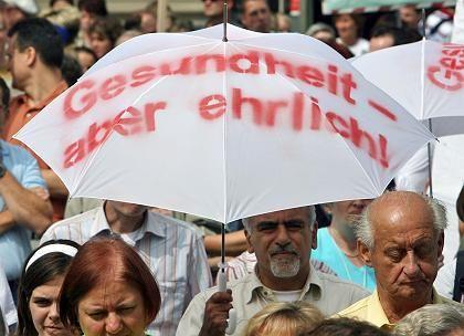 Ärzte-Demo in Mainz: Reale Kosten höher als die Beiträge