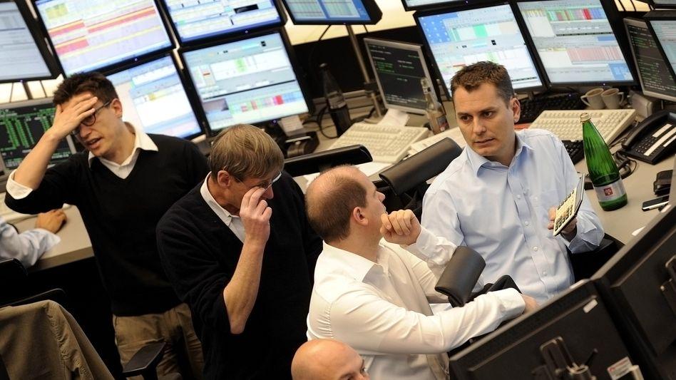 Nachdenkliche Börsianer: Der Dax taucht in Folge einer schwachen Wall Street ab