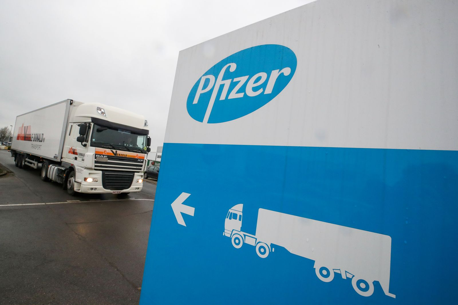 FILE PHOTO: A refrigerated truck leaves the Pfizer plant in Puurs