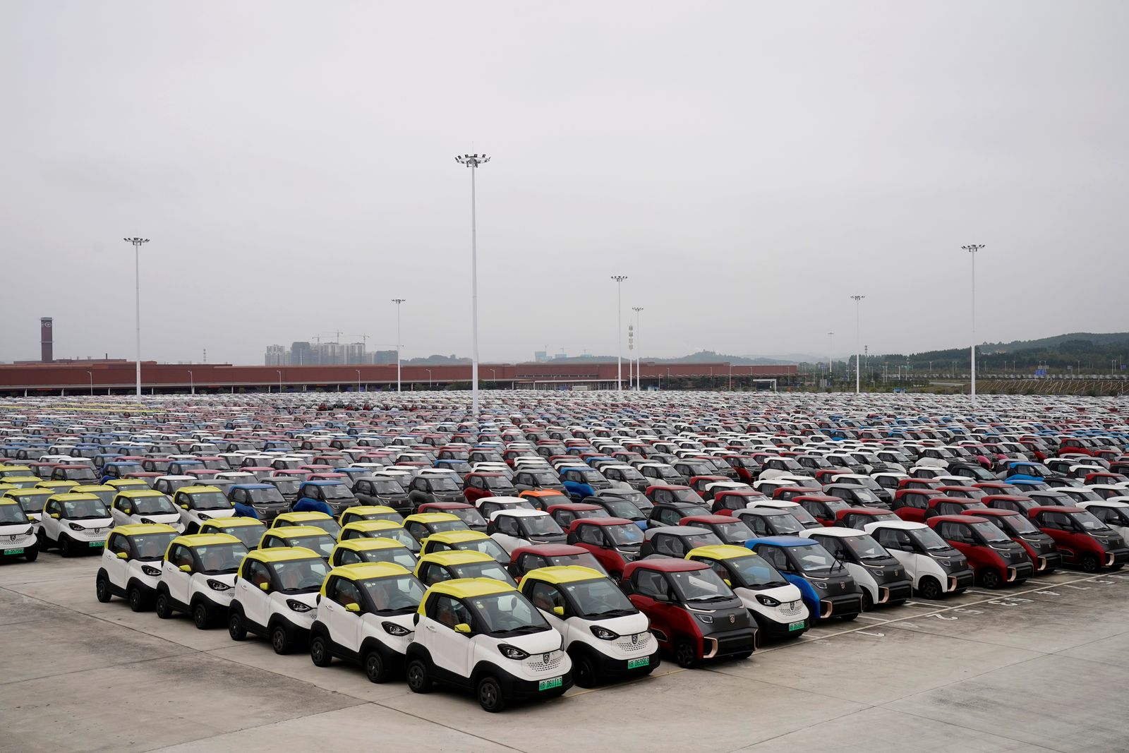 Baojun E100 and E200 all-electric battery cars sit parked at a parking lot operated by General Motors Co and its local joint-venture partners in Liuzho