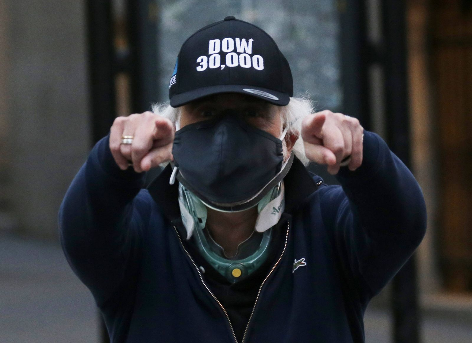 Trader Peter Tuchman reacts after he exits the New York Stock Exchange wearing DOW 30,000 hat after the closing Bell at
