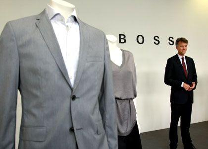 Im Strudel der Krise: Auch Hugo Boss (hier Chef Claus-Dietrich Lahrs) baut Stellen ab