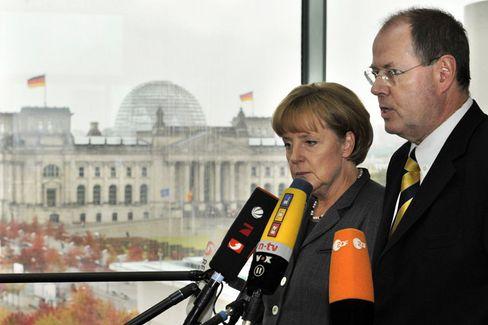 """Merkel, Steinbrück: """"Die Spareinlagen sind sicher"""""""