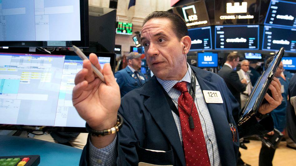 Händler an der Wall Street: Steigende Risikoprämien drücken die Kurse am Rentenmarkt. Dies sorgt für Kaufchancen bei einigen Unternehmens-Bonds