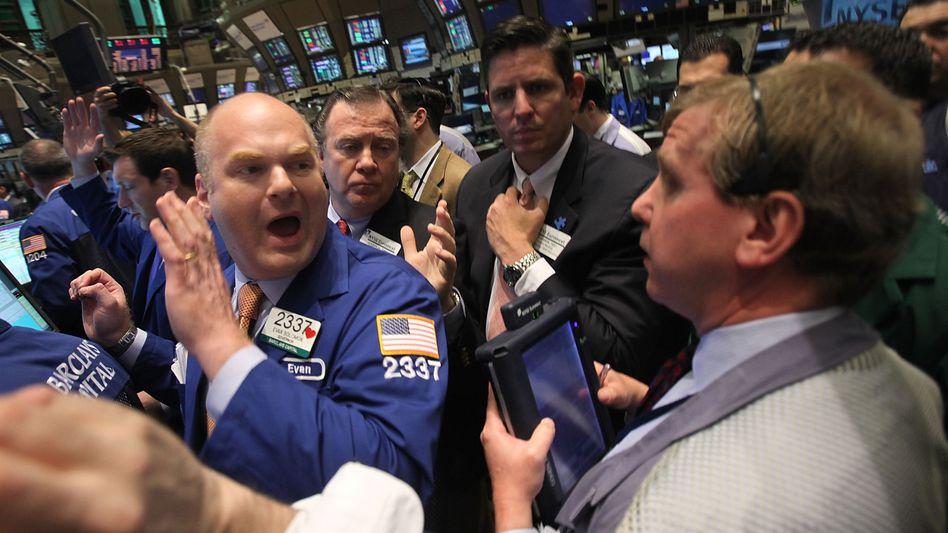 Händler an der Wall Street: Der Start der US-Bilanzsaison dürfte auch den Dax bewegen