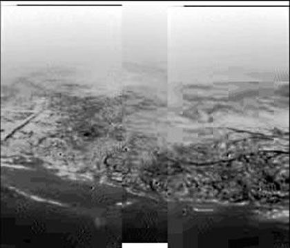BU:A boundary between high, lighter-coloured terrain and and darker lowland area on Titan