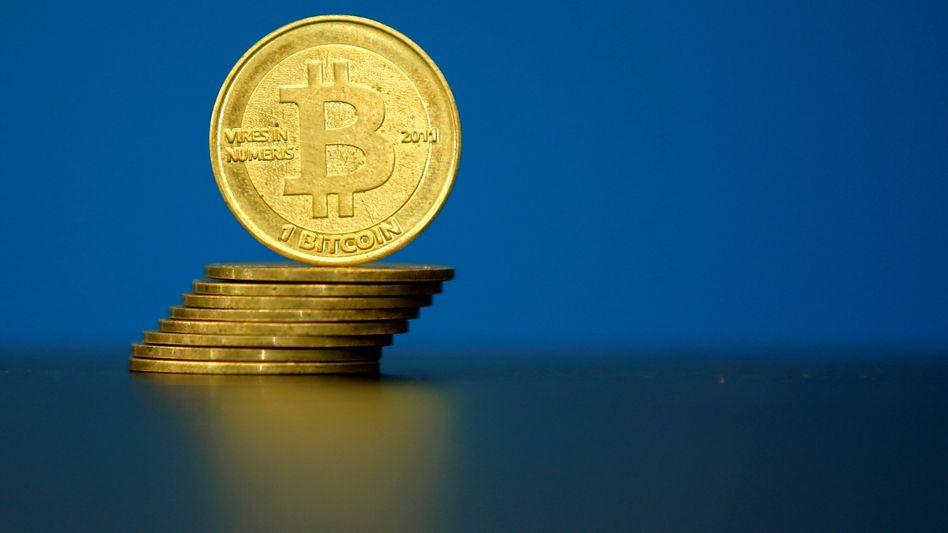 Bereits in aller Munde und bald in aller Depot? Bitcoins haben eine enorme Wertsteigerung hinter sich - der Kurs schwankt jedoch stark