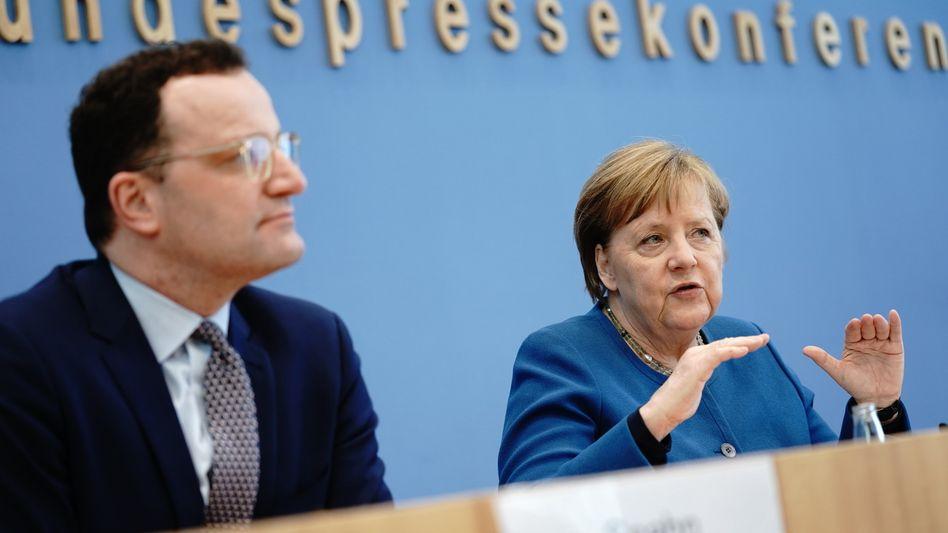 Angela Merkel, Jens Spahn: Gemeinsamer Auftritt überfällig