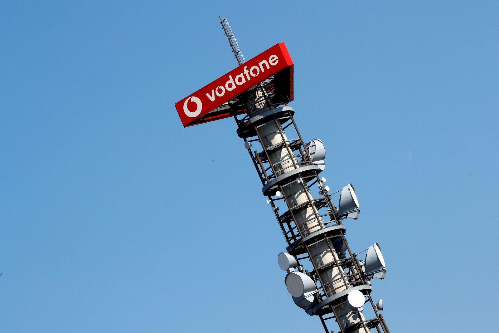 FILE PHOTO: Different types of 4G, 5G and data radio relay antennas for mobile phone networks are pictured on a relay mast operated by Vodafone in Berlin