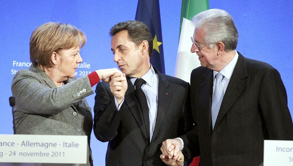 Krisengespann: Angela Merkel, Nicolas Sarkozy und Mario Monti