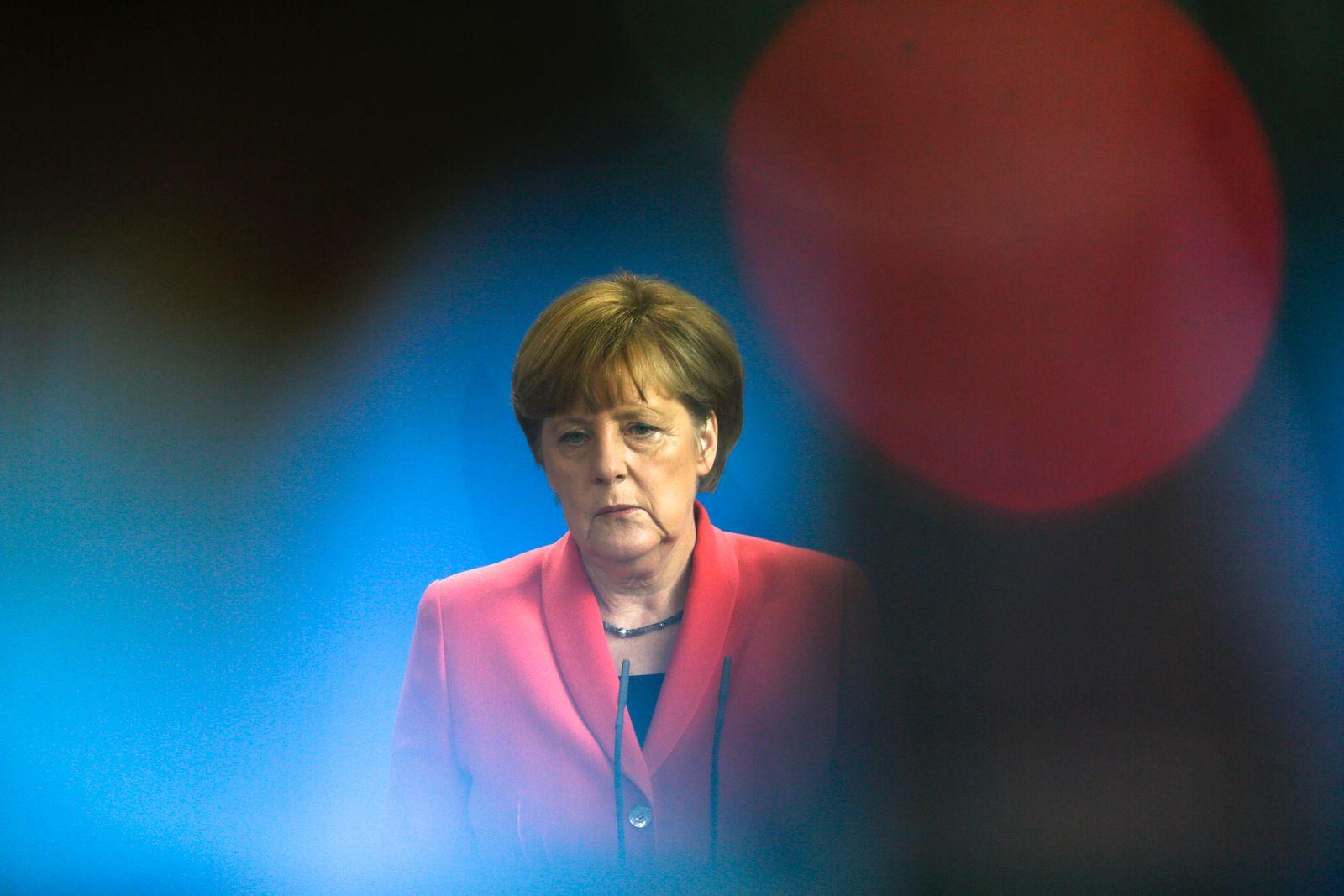 Merkel/ Traurig
