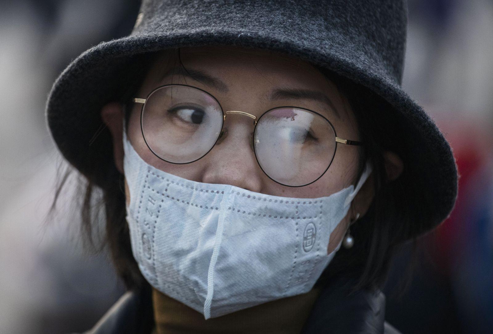 Coronavirus / China / Mundschutz / Frau
