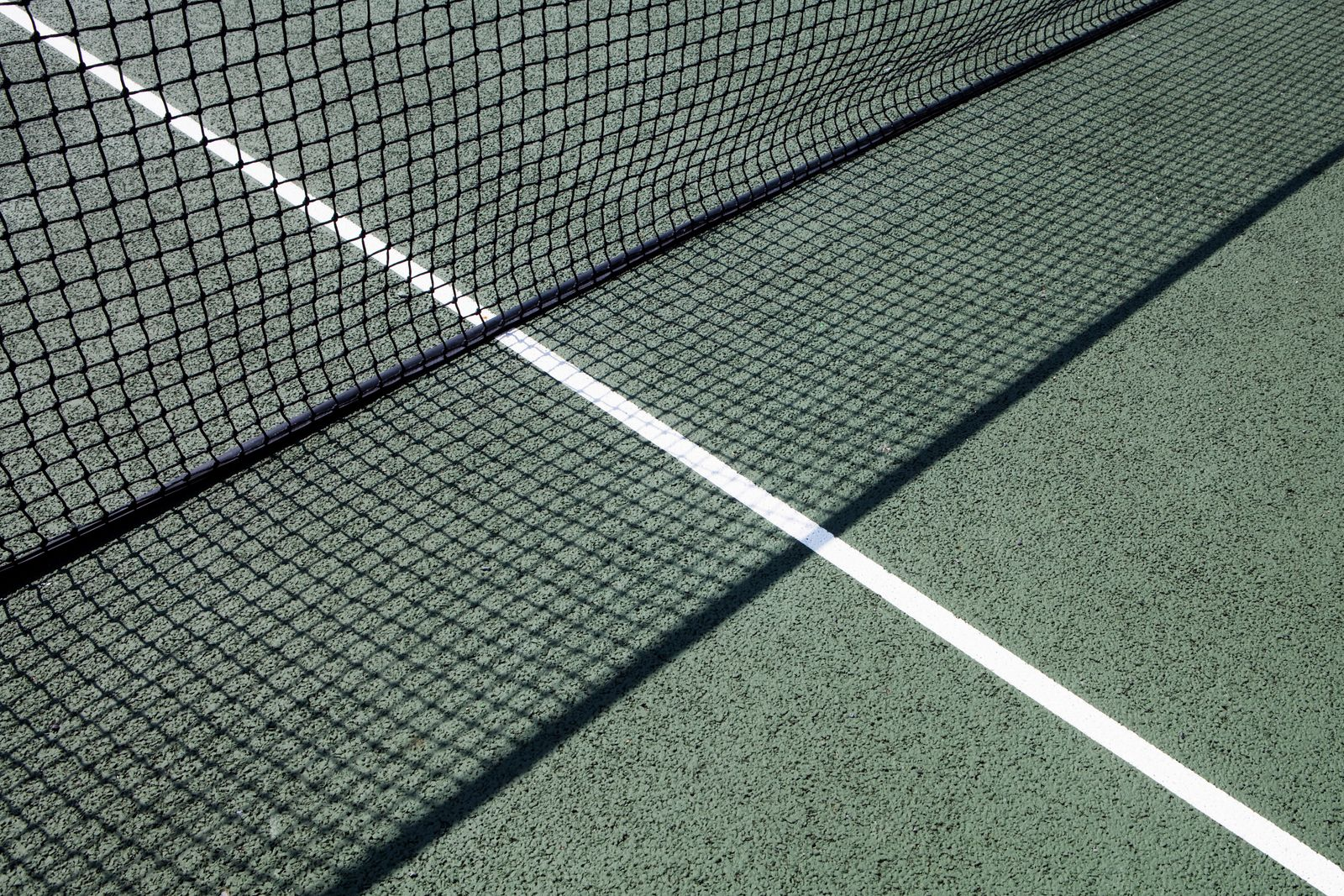 Tennis net on court at day time