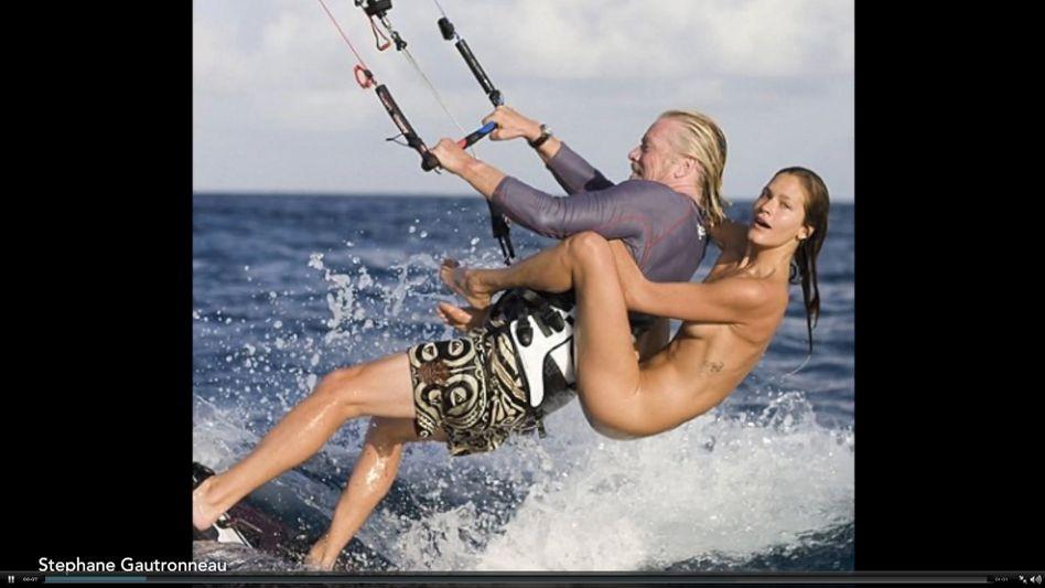 Ab in den Urlaub: Der begnadete Selbstdarsteller Richard Branson (hier mit einem Fotomodell beim Surfen) hat 170 seiner Angestellten eine Urlaubs-Flatrate verpasst