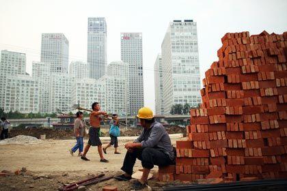 Viel zu tun: Ein Bauarbeiter in Peking