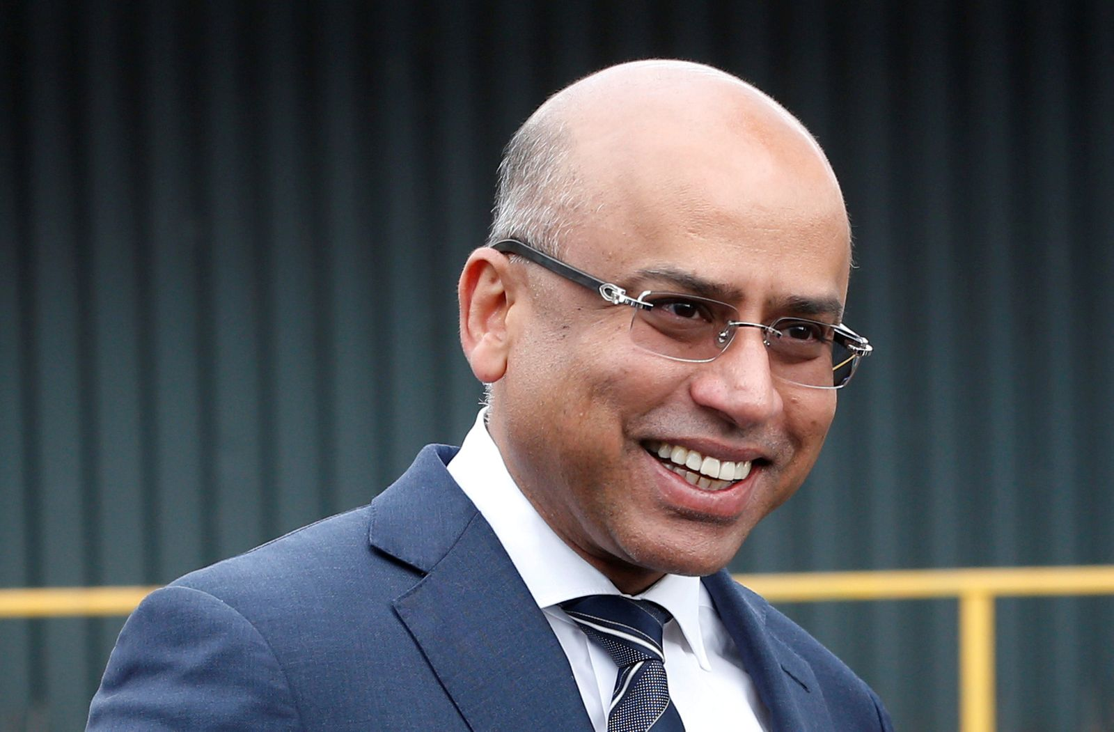 FILE PHOTO: Liberty Steel's Sanjeev Gupta smiles outside their newly acquired Liberty Steel processing mill in Dalzell, Scotland