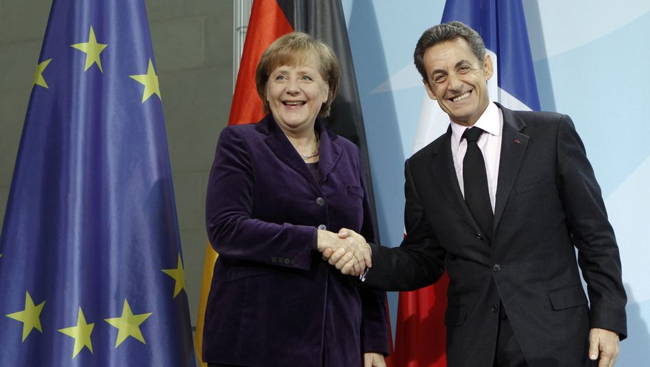 Shake-Hands: Merkel und Sarkozy in Berlin