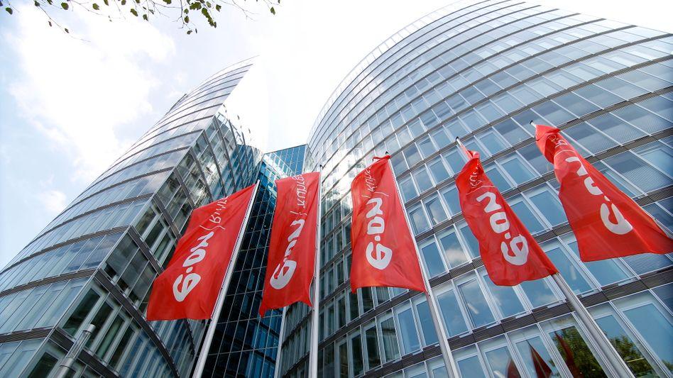 Eon-Zentrale in Essen: Vor der Energiewende hat Eon seinen Aktionären eine Dividende von mindestens 1,30 Euro versprochen