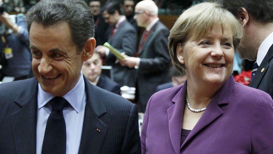 Kanzlerin Merkel, Frankreichs Regierungschef Sarkozy: Erfolg der Euro-Fighter gegen die britischen Bremser