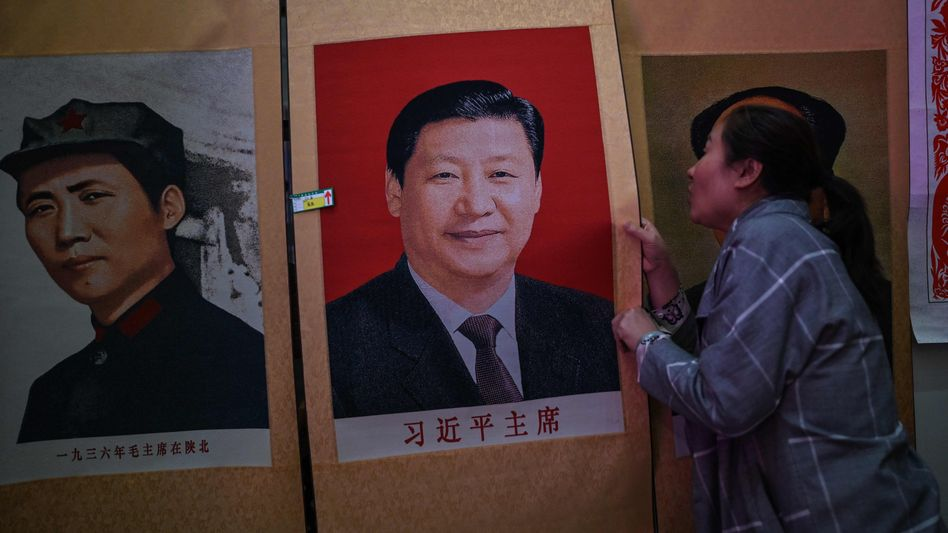 Unsicheres Siegerlächeln: Poster mit dem Porträt von Chinas Präsident Xi Jinping
