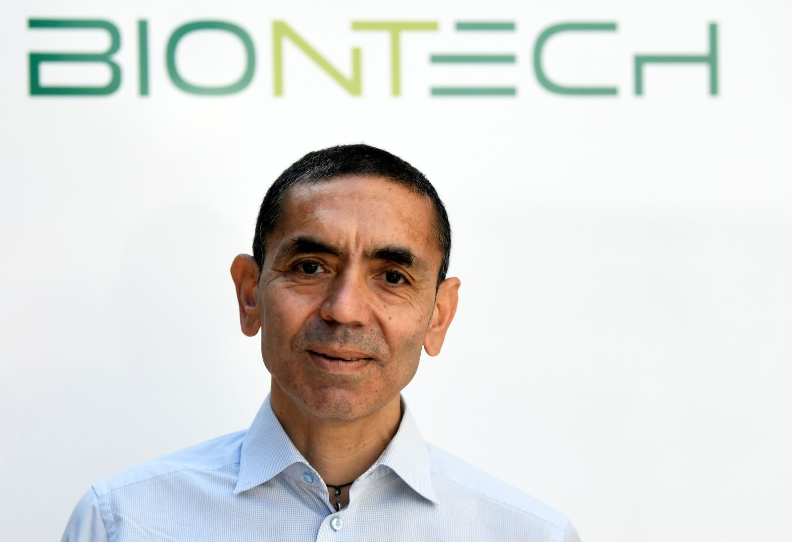 Ugur Sahin, CEO and co-founder of German biotech firm BioNTech, is interviewed by journalists in Marburg