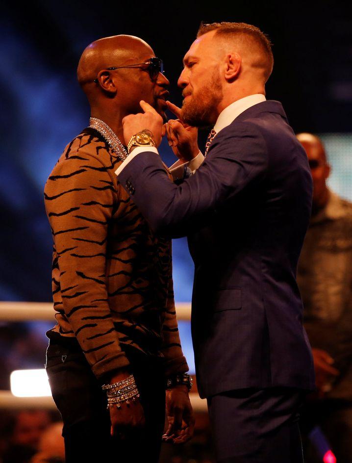 "Floyd ""Money"" Mayweather und Conor ""The Notorious"" McGregor (rechts)"