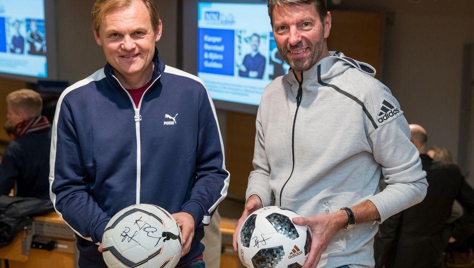Adidas-Chef Kasper Rorsted (r), Puma-Chef Björn Gulden: Kursgewinne im Jahr 2018