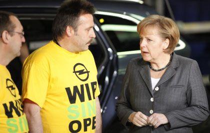 """""""Der Staat soll Brücken bauen"""": Kanzlerin Merkel wandte sich in Rüsselsheim erneut gegen eine direkte Staatsbeteiligung"""