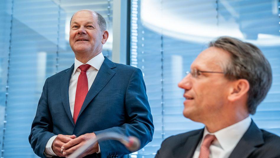 Minister Scholz, Staatssekretär Jörg Kukies: Freude an den Grünen