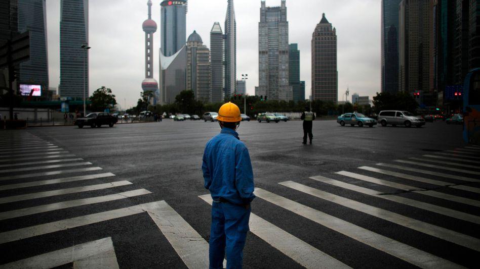 Bauarbeiter in Shanghai: China dürfte laut OECD die Talsohle durchschritten haben