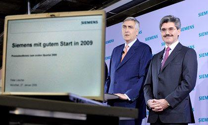 Guter Jahresstart: Siemens-Chef Löscher (l.) und Finanzchef Kaeser